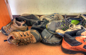 I found pictures of bigger piles, but I've got that pair of Merrells on the left there. Public domain photo via GoodFreePhotos.